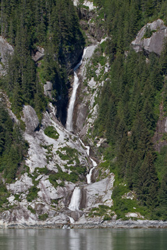 A waterfall flowing into Tracy Arm